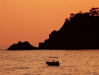Orange Boat At Sea Free JPG