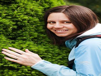 Young Woman Hugging Tree